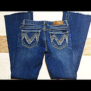 Seven jeans with frayed bottoms